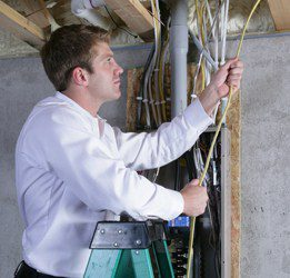 Electrician wiring a home